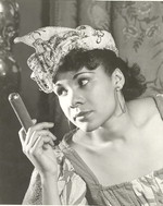Katherine Dunham in an undated photograph as Woman with a Cigar from Tropics [photograph]