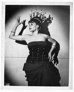 [Katherine Dunham, dancer, three-quarter length portrait, facing left, wearing dance costume] [photograph]