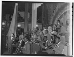 [Portrait of Duke Ellington, Ray Nance, Tricky Sam Nanton(?), Johnny Hodges(?), Ben Webster(?), Otto Toby Hardwick(e), Harry Carney, Rex William Stewart, Juan Tizol, Lawrence Brown, Fred Guy(?), and Sonny Greer, Howard Theater, Washington, D.C., early 1940] [graphic]