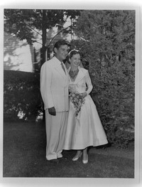 Bernstein with Felicia at their wedding. Bernstein's suit had previously belonged to Serge Koussevitzky. September 9, 1951. (Music Division) [Photographs]