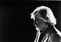 [Gerry Mulligan in profile with black background] [photograph]