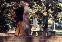 [Gerry Mulligan, playing saxophone, with children] [photograph]