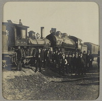 Band members wait out clearing of train wreck [en route from Portland to Spokane] [photograph]
