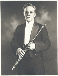 Dayton C. Miller with 22k and 18k-gold flute which he made in 1902-1905, photograph, 1922