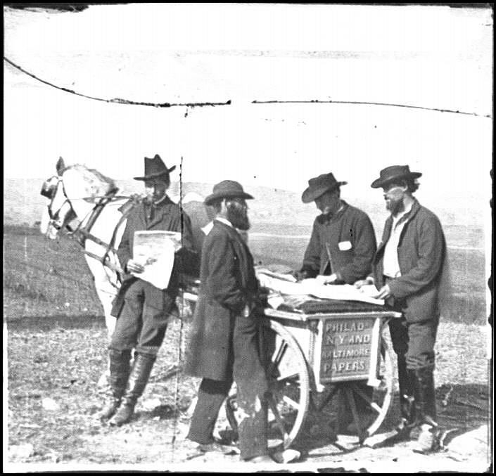 [Virginia. Newspaper vendor and cart in camp]