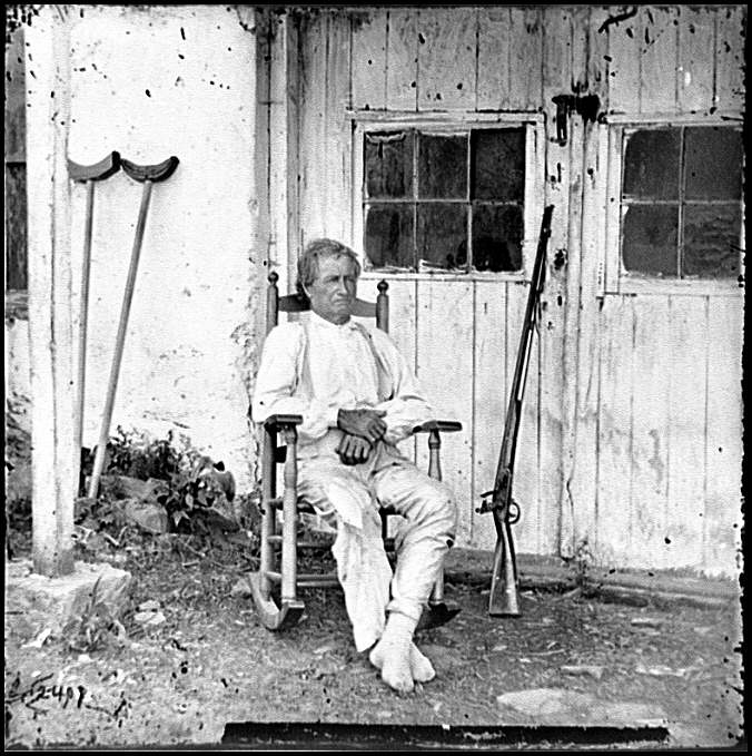 "[Gettysburg, Pa. John L. Burns, the ""old hero of Gettysburg,"" with gun and crutches]"