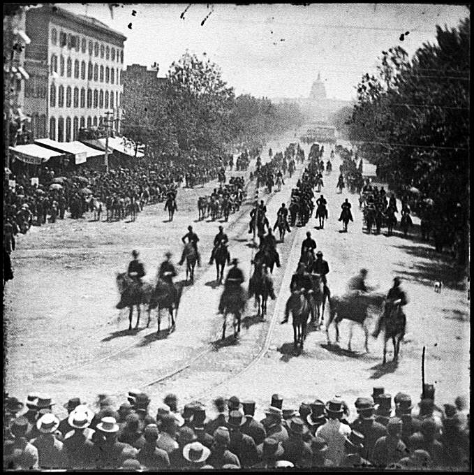 [Washington, D.C. Mounted officers and unidentified units passing on Pennsylvania Avenue near the Treasury]