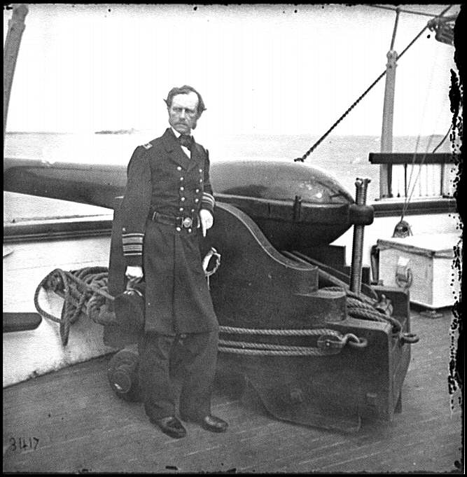 [Charleston Harbor, S.C. Rear Admiral John A. Dahlgren standing by a Dahlgren gun on deck of U.S.S. Pawnee]