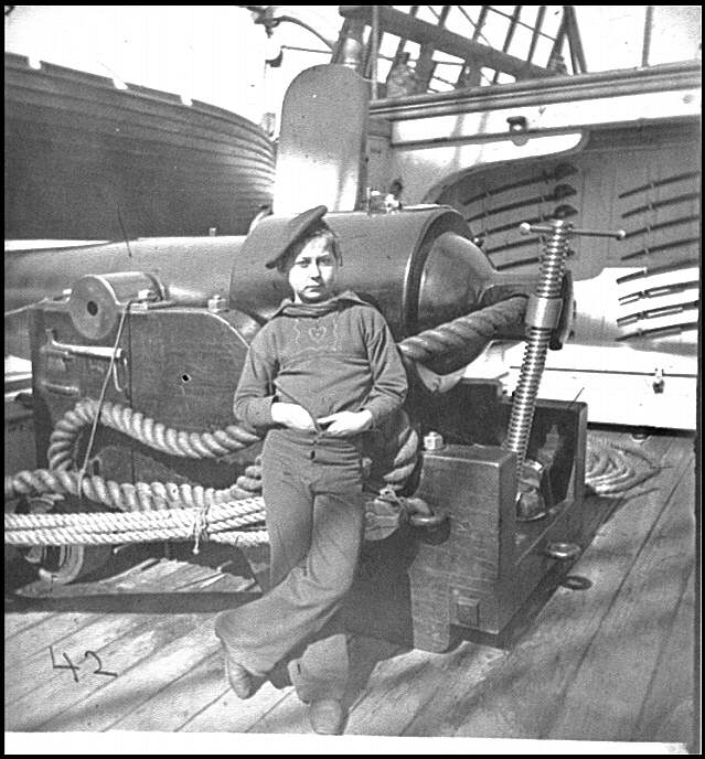 [Powder monkey by gun of U.S.S. New Hampshire off Charleston, S.C.]