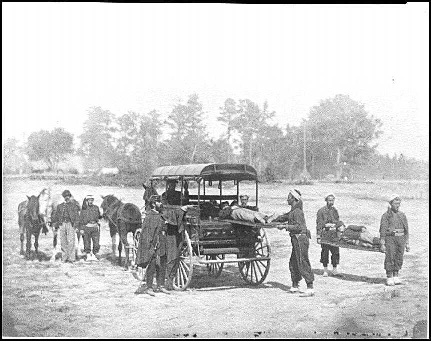 [Unknown location. Zouave ambulance crew demonstrating removal of wounded soldiers from the field; another view]