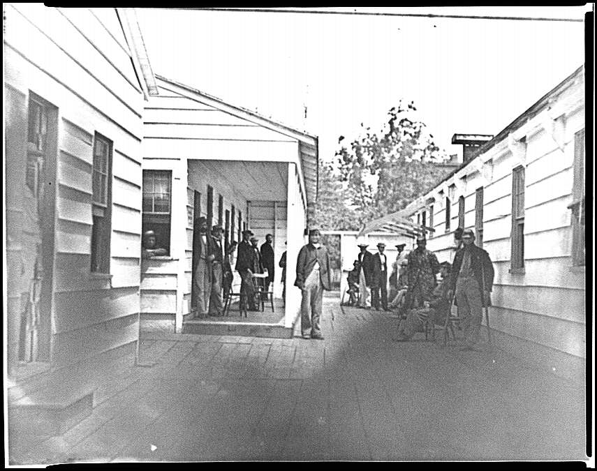 [Washington, D.C. Convalescent soldiers and others outside quarters of the Sanitary Commission Home Lodge]