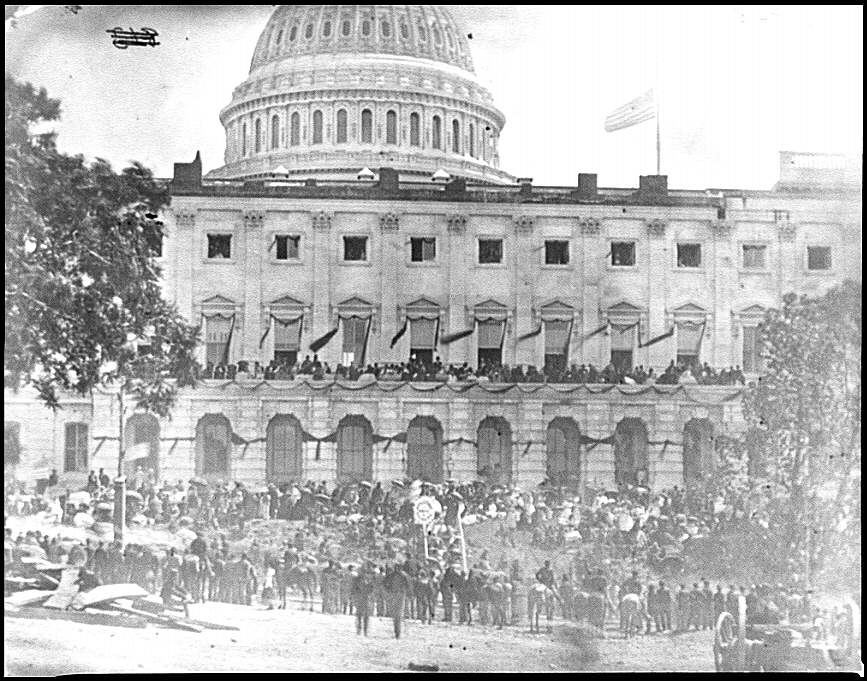 [Washington, D.C. Spectators at side of the Capitol, which is hung with crepe and has flag at half-mast]