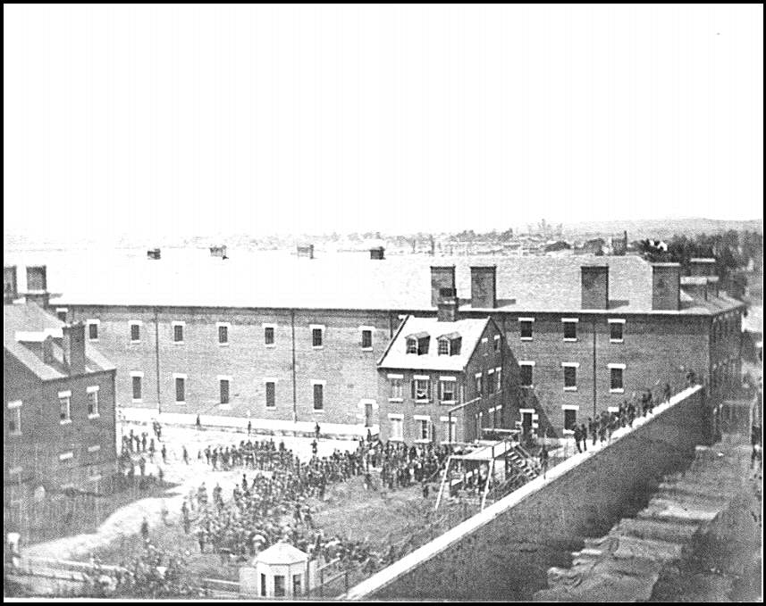 [Washington, D.C. Execution of the conspirators: scaffold in use and crowd in the yard, seen from the roof of the Arsenal]