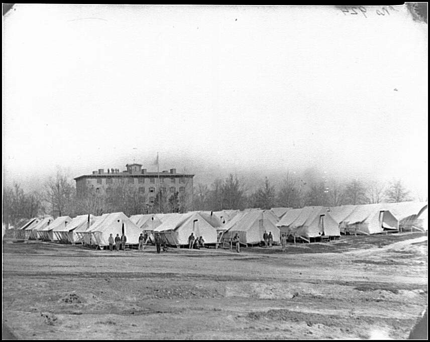 [Washington, D.C. Hospital tents at Camp Carver, with Columbian College building]