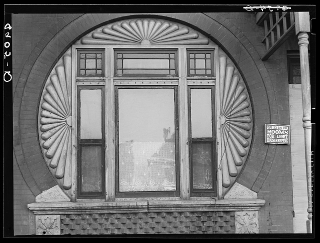 Window in rooming house. Omaha, Nebraska.  John Vachon, photographer. Nov. 1938.  Library of Congress.