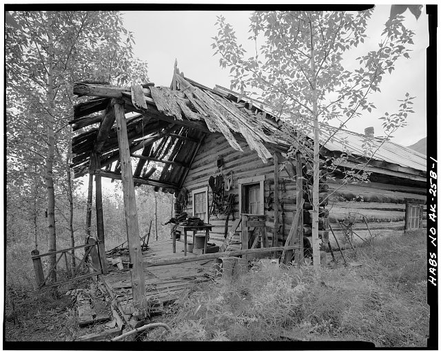 1.  FRONT PORCH CORNER, LOOKING SOUTHWEST - Pioneers of Alaska Igloo No. 8, Koyukuk River at Wiseman Creek, Bettles Vicinity, Wiseman, Yukon-Koyukuk Census Area, AK