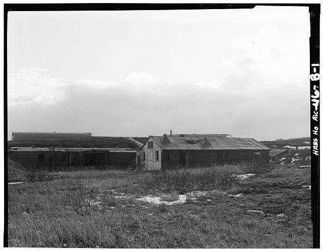 1.  ON HILLSIDE ABOVE ADDITIONAL WARDS AND OFFICES, SHOWING WOOD FRAME CORRIDORS TO REAR - Fort Randall, Latrine & Bath, Northeast of intersection of California Boulevard & Nurse Drive, Cold Bay, Aleutian Islands, AK