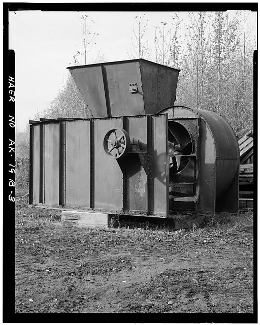 3.  OBLIQUE VIEW SHOWING FOUR-BELT DRIVE WHEEL AND FAN HOUSING, LOOKING WEST - Eska Coal Mine, Jeffery Fan-Blower Unit, Wishbone Hill, Sutton, Matanuska-Susitna Borough, AK