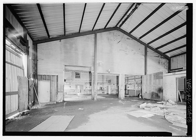 Interior view looking south in center room, of original north exterior wall of machine shop - Equipment Garage & Machine Shop, Haul Road, Saint Paul, Aleutians West Census Area, AK