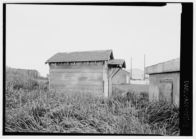 Side view, looking north - Salt Water (Brine) Well Houses, Haul Road, Saint Paul, Aleutians West Census Area, AK