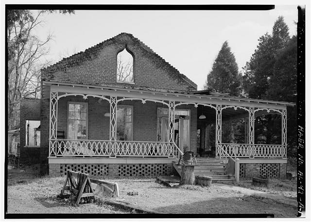 EXTERIOR VIEW, LOOKING SOUTHEAST, WITH FRONT FACADE AND PORCH. FREE STANDING BRICK GABLED ROOF SHOWS EVIDENCE OF RECENT FIRE WHICH PARTIALLY DESTROYED THE PROPERTY WHICH WAS BUILT IN THE 1840S FOR THE THEN IRON MASTER HORACE WARE. - Shelby Iron Works, Iron Master's House, County Road 42, Shelby, Shelby County, AL
