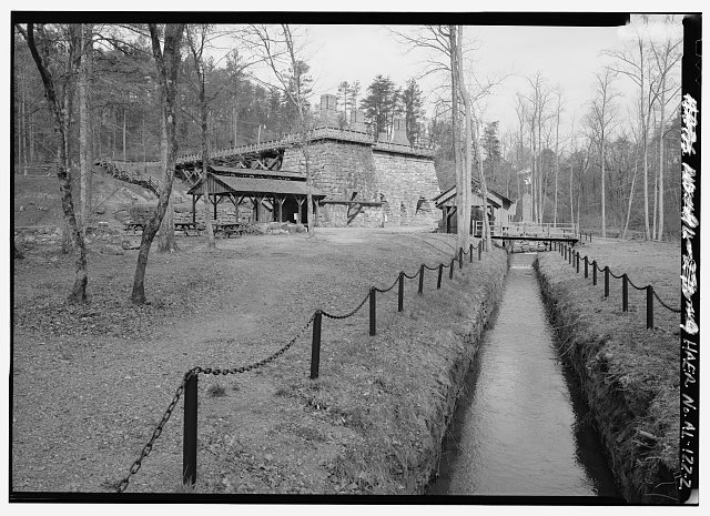 GENERAL VIEW OF FURNACE COMPLEX AND RACEWAY, LOOKING NORTHWEST. - Tannehill Furnace, 12632 Confederate Parkway, Tannehill Historical State Park, Bucksville, Tuscaloosa County, AL