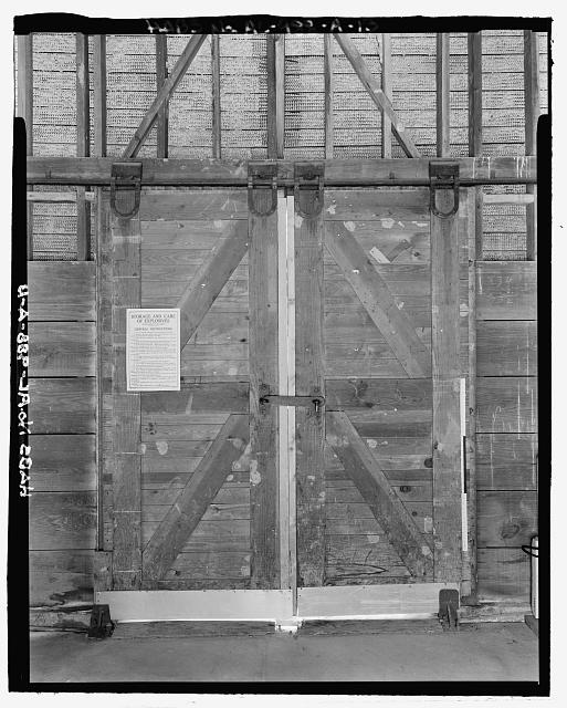 Interior planar view of doors to railroad platform at rear of ammunition storage building 4403, view towards the west westside with scale - Fort McClellan Ammunition Storage Area, Building No. 4403, Second Avenue (Magazine Road), Anniston, Calhoun County, AL