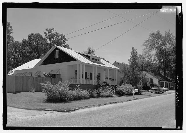 View of 501 8th St., a side-gable duplex bungalow with engaged porch and paired and clustered columns. Built as worker housing for Lanett Cotton Mill - 501 Eighth Street (House), 501 Eighth Street, Lanett, Chambers County, AL