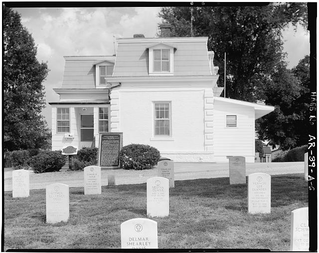 6.  NORTH ELEVATION SHOWING TOMBSTONES IN FRONT OF LODGE - Fayetteville National Cemetery, Superintendent's Lodge, 700 Government Avenue, Fayetteville, Washington County, AR