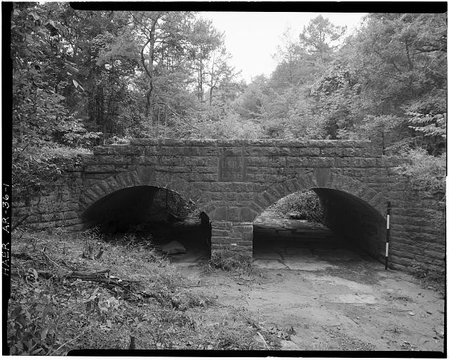 1.  GENERAL VIEW, LOOKING WEST, SHOWING EAST ELEVATION (SCALE ROD IS MEASURED IN FEET) - Spring Lake Bridge, Spanning Bob Barnes Branch at County Road No. 36D, Belleville, Yell County, AR