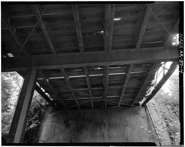 4.  VIEW, LOOKING WEST, SHOWING WEST ABUTMENT AND FLOOR BEAM-STRINGER SYSTEM - Achmun Creek Bridge, Spanning Achmun Creek at County Road 222, Ola, Yell County, AR
