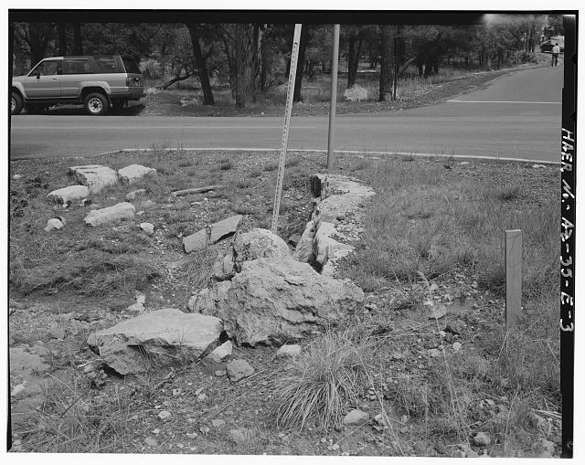 VIEW OF THE TOP OF THE HEADWALL LOOKING EAST - Grand Canyon National Park Roads, Apache Street Headwall No. 1, Northwest corner of intersection of Apache Street and Center Road, Grand Canyon Village, Coconino County, AZ