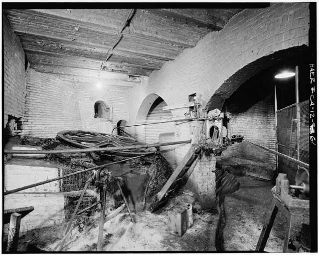 61.  VIEW TO SOUTHEAST IN MAIN SHEAVE VAULT: View towards the southeast in the main sheave vault under the southeast corner of the Washington and Mason Street powerhouse. Photograph shows the Powell-Mason and Powell-Hyde outbound deflecting sheaves. - San Francisco Cable Railway, Washington & Mason Streets, San Francisco, San Francisco County, CA