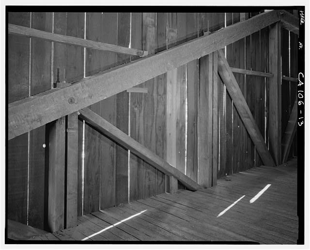 13.  INTERIOR VIEW OF CONSTRUCTION DETAIL ALONG EAST WALL. - Wawona Covered Bridge, Spanning South Fork Merced River on service road, Wawona, Mariposa County, CA