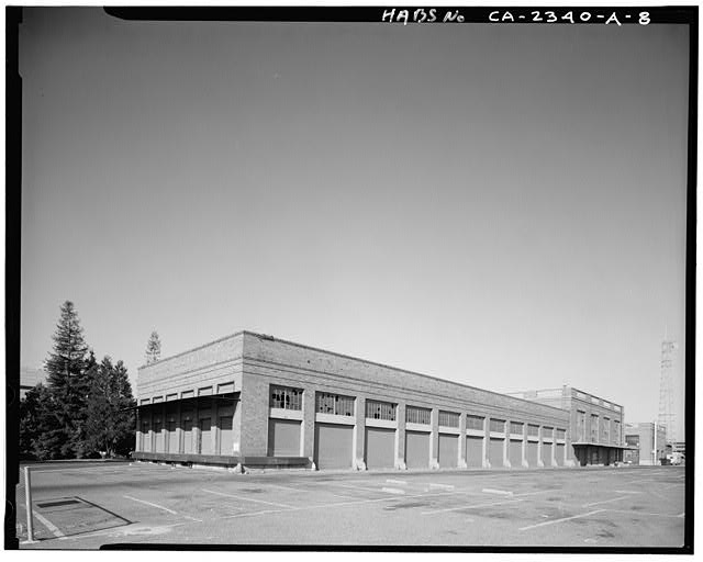 View of east end of loading dock and Railway Express Building, facing southwest. Southern Pacific Depot visible at right (west) - Southern Pacific Railroad Depot, Railroad Terminal Post Office & Express Building, Fifth & I Streets, Sacramento, Sacramento County, CA