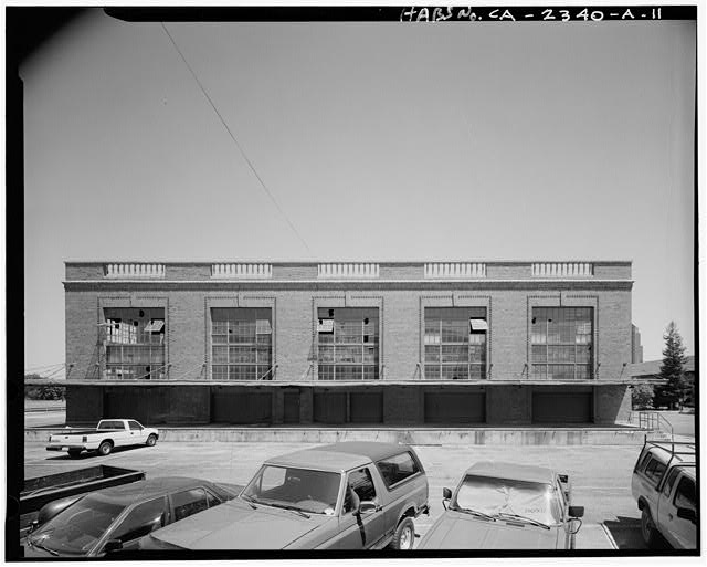 View of American Railway Express Building, facing east. Metal Canopy projects above roll-up doors and elevated dock - Southern Pacific Railroad Depot, Railroad Terminal Post Office & Express Building, Fifth & I Streets, Sacramento, Sacramento County, CA