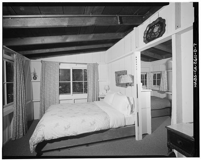 7.  View southwest of 'Chalet' room from doorway. Windows beyond bed are in southwest end of building, while those at left overlook Castro Creek Canyon. Scale visible against door frame near head of bed. - Deetjen's Big Sur Inn, Champagne Building, East Side of State Highway 1, Big Sur, Monterey County, CA