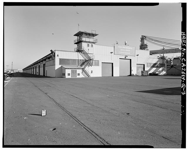 3.  WEST AND NORTH SIDES (OBLIQUE VIEW OF NORTH SIDE), FROM WESTERN END OF PIER 4, LOOKING EAST. - Oakland Naval Supply Center, Pier Transit Shed, Pier 4, Oakland, Alameda County, CA