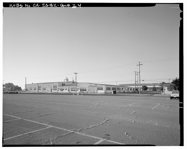 Contextual view of Fyffe Avenue and James Drive.  Fire station (building no. 117) is shown on left.  Camera facing northeast. - Naval Supply Annex Stockton, Rough & Ready Island, Stockton, San Joaquin County, CA