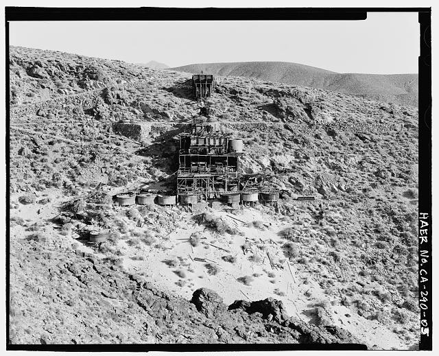 5.  NORTH ELEVATION OF SKIDOO MILL, LOOKING SOUTH. TAILINGS IN FOREGROUND, DOWN SLOPE FROM SYANIDE PROCESSING TANKS. SEE CA-290-40 (CT) FOR IDENTICAL COLOR TRANSPARENCY. - Skidoo Mine, Park Route 38 (Skidoo Road), Death Valley Junction, Inyo County, CA