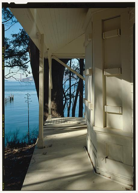View of porch with bay window and pier in background from northeast - Camp Reynolds, Band Master's Quarters, Angel Island State Park, Angel Island, Marin County, CA