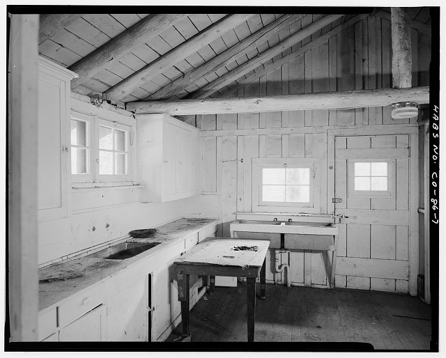 Timber Creek bunkhouse and mess hall, Rocky Mountain National Park.  Interior, kitchen and dining area, viewing north. - Timber Creek Bunkhouse & Mess Hall, Trail Ridge Road, Grand Lake, Grand County, CO