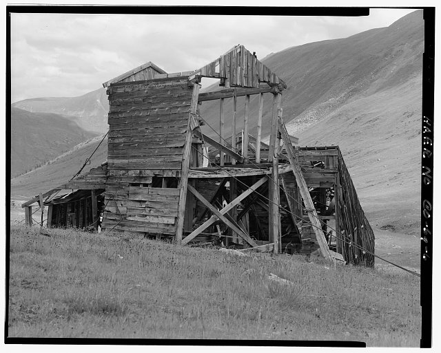 6.  EXTERIOR VIEW OF MILL FROM SOUTHWEST. TRAMWAY TERMINUS IN FOREGROUND. - Sound Democrat Mill, Placer Creek Valley, Silverton, San Juan County, CO