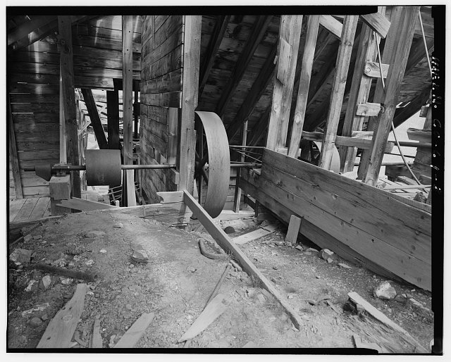 8.  INTERIOR VIEW OF MILL DRIVE SHAFTS AND WHEELS. - Sound Democrat Mill, Placer Creek Valley, Silverton, San Juan County, CO