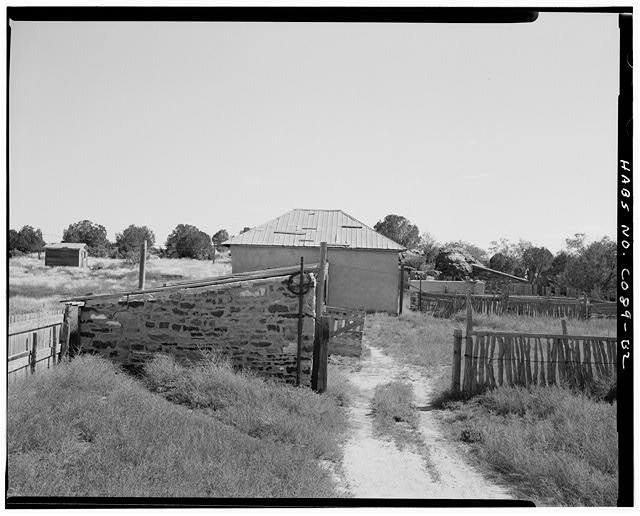 Abode Barn, right side, attached shed in foreground, looking southeast. - Adam & Bessie Arnet Homestead, Adobe Barn, East & adjacent to stone shed, Model, Las Animas County, CO