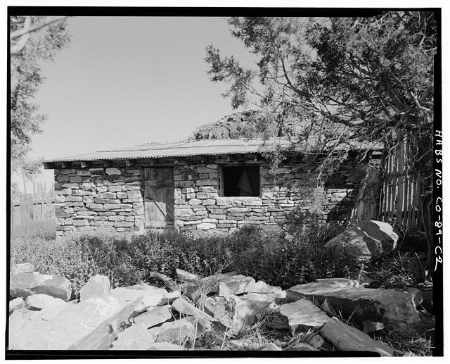 Stone outbuilding, front, looking north. - Adam & Bessie Arnet Homestead, Stone Outbuilding, 40 feet southeast of Adobe Barn, Model, Las Animas County, CO