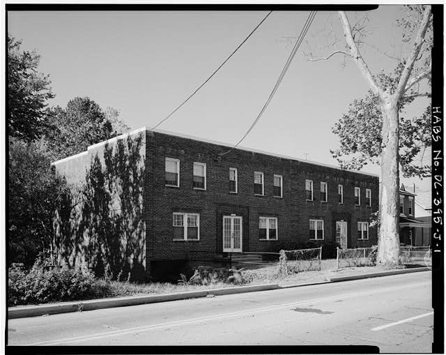 1.  VIEW WEST, SHOWING EAST (FRONT) ELEVATION - Howard Road Historic District, Henry F. Miller Apartment Building, 1101-1107 Howard Road, Washington, District of Columbia, DC