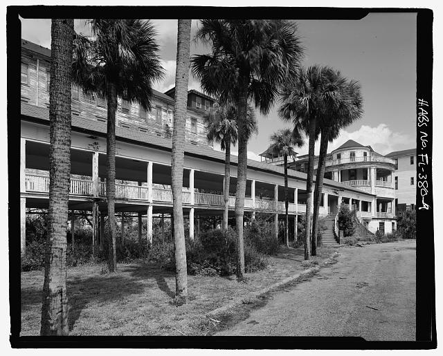 FRONT, WEST WING, VERANDAH AND STAIRS TO MAIN ENTRANCE: CAMERA DIRECTION EAST AND NORTHEAST  - Ormond Hotel, 15 East Granada, Ormond Beach, Volusia County, FL
