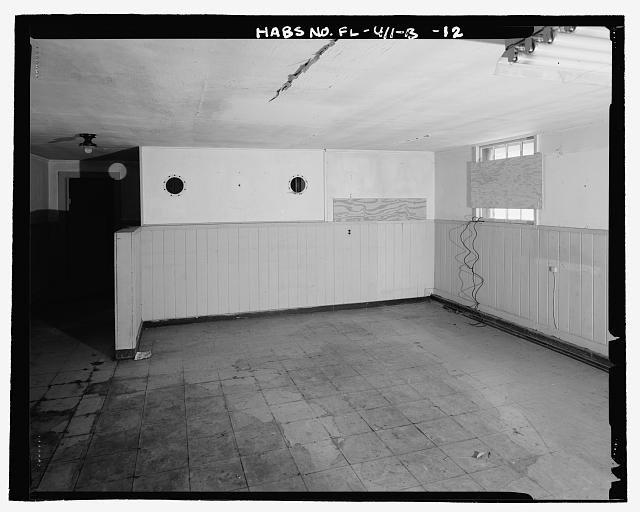 INTERIOR, LARGE OPEN AREA AT THE NORTHERN END OF THE BUILDING, SHOWING CIRCULAR OPENINGS IN DIVIDING WALL, LOOKING NORTH - Eglin Air Force Base, Storehouse & Company Administration, Southeast of Flager Road, Nassau Lane, & southern edge of Weekly Bayou, Valparaiso, Okaloosa County, FL
