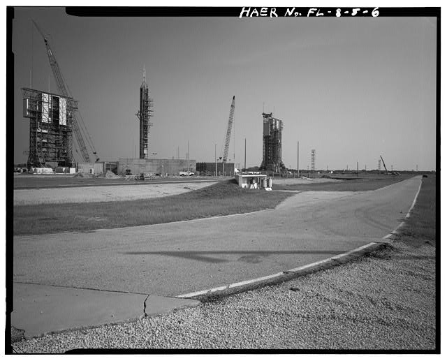 6.  GENERAL VIEW INSIDE LAUNCH PAD B FROM NORTHEAST CORNER OF SITE SHOWING RELATIONSHIP OF GANTRIES TO PERIMETER ROAD; VIEW TO NORTHWEST. - Cape Canaveral Air Station, Launch Complex 17, East end of Lighthouse Road, Cape Canaveral, Brevard County, FL